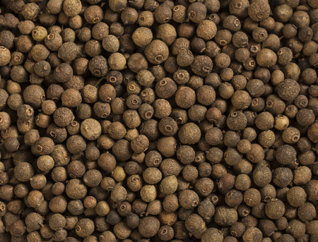 Allspice spice background. Natural seasoning texture. 写真素材