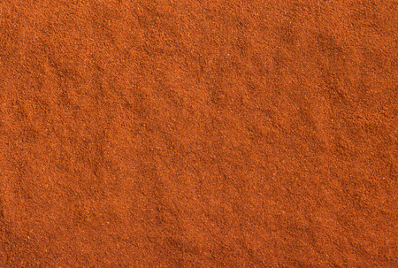 Red ground paprika texture. Background of hot chili pepper. Seasoning background. 写真素材