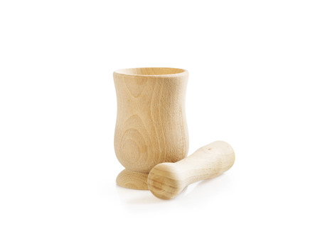 Wooden mortar and pestle set isolated on white. Kitchen utensil.