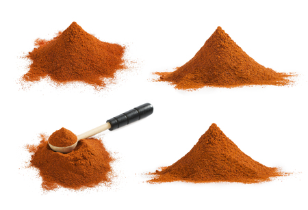 Set of ground red paprika pile isolated on white background. 写真素材