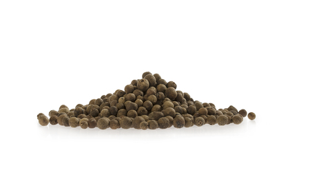 Allspice spice pile isolated on white background. Arrangement in stack.