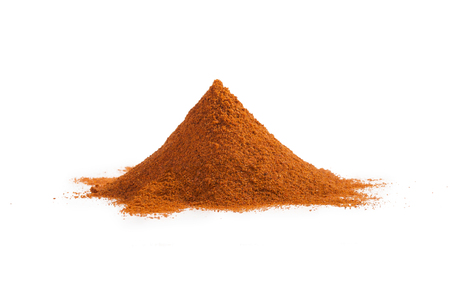 Pile of red ground paprika isolated on white background. Heap of hot chili pepper.