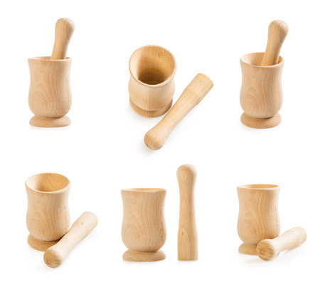 Big set of wooden mortar and pestle isolated on white. Kitchen utensil.