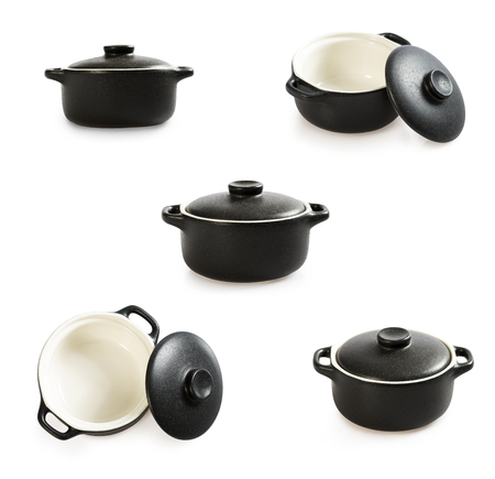 Big set of cooking pot isolated on white. Black colour outside and white inside. Baking pot.