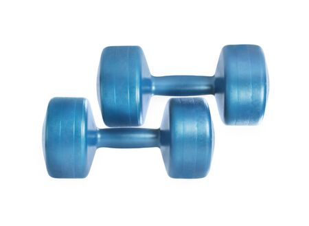 Flat lay view of blue fitness dumbbells isolated on white background. Studio shot. Clipping path included. Banque d'images