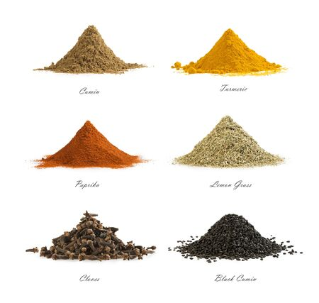 Collection of different spices isolated on white background. Set of mix seasoning. Cumin, turmeric, red paprika, lemon grass, cloves, black cumin.