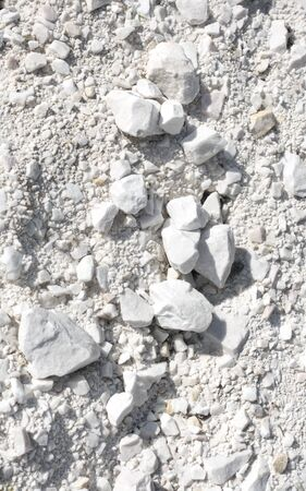 Marble stones and dust. Marble mine in Macedonia, natural background of white rock.