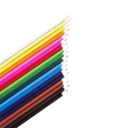 Colored pencils in row isolated on white background. Back to school concept with negative space.