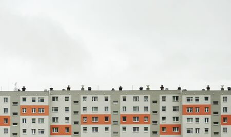 Block of flats against a cloudy sky. Lot of space for text. Polish architecture. Poland