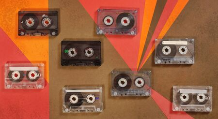 Vintage music cassette tape on retro background. Flat lay. 70's, 80's, 90's old school record technology poster.