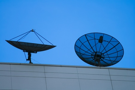 Satellite dish at sunset photo