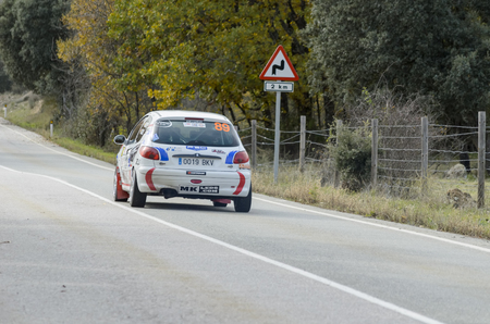 martinez: MADARQUILLOS, SPAIN - NOVEMBER 22th 2014: Spain rally championship. David Martinez and Sergio Cerzo driving a Peugeot 206 XS, during Madrid-RACE rally, on November 22th 2014.