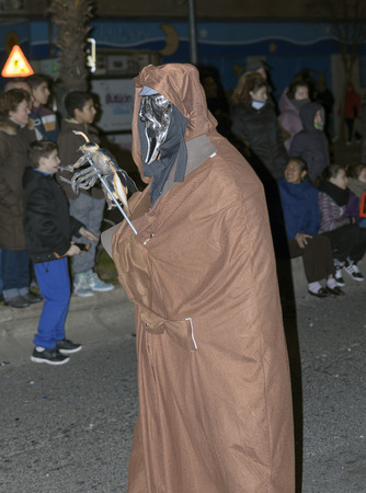 fairs: TORREJON DE ARDOZ, SPAIN - FEBRUARY 14th 2015: Unknown people watching unknown person dressed up of death, during carnival fairs, in Torrejon de Ardoz, on February 14th 2015.