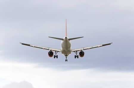 MADRID, SPAIN - FEBRUARY 14th 2015: Airplane -Airbus A319-, of -EasyJet- airline, landing on Madrid-Barajas -Adolfo Suarez- airport, on February 14th 2015.