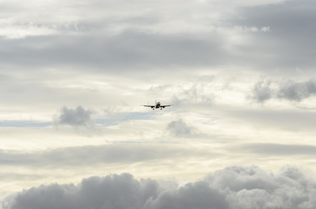 february 14th: MADRID, SPAIN - FEBRUARY 14th 2015: Unknown airplane of unknown airline, approaching to Madrid-Barajas -Adolfo Suarez- airport, throught a sea of clouds, on February 14th 2015.