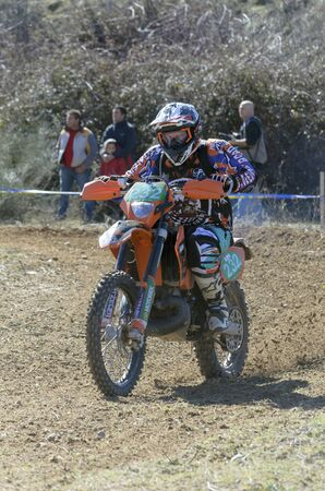 arroyo: GUADALAJARA, SPAIN - FEBRUARY 22th 2015: Spain amateur cross country championship. Unknown people watching to Jose Antonio Arroyo de los Rios driving his motorcycle, in Guadalajara, on February 22th 2015. Editorial