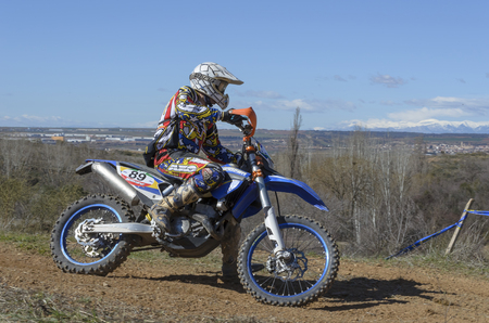 martinez: GUADALAJARA, SPAIN - FEBRUARY 22th 2015: Spain cross country championship. Juan R. Martinez Carpena driving his motorcycle, during first race of season 2015, in Guadalajara, on February 22th 2015. He finished eleventh (Veterans rank)