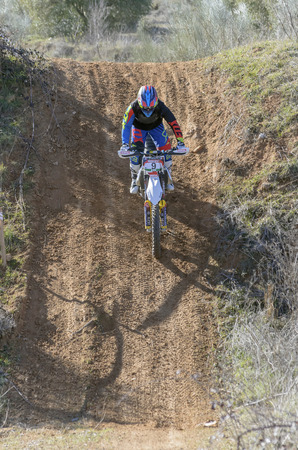 marcos: GUADALAJARA, SPAIN - FEBRUARY 22th 2015: Spain cross country championship. Marcos Barbero Andres drives his husqvarna motorcycle, during first race of season 2015, in Guadalajara, on February 22th 2015. Editorial