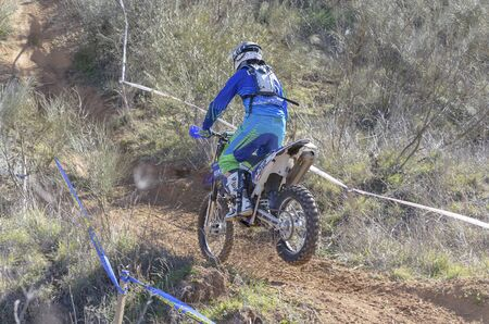 GUADALAJARA, SPAIN - FEBRUARY 22th 2015: Spain cross country championship. Unknown biker drives his motorcycle, during first race of season 2015, in Guadalajara, on February 22th 2015.