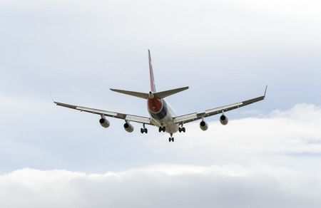 february 14th: MADRID, SPAIN - FEBRUARY 14th 2015: Airplane -Iliushin IL-96-300-, of -Cubana Airlines- airline, landing on Madrid-Barajas -Adolfo Suarez- airport, on February 14th 2015.