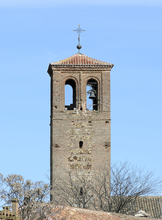 recite: Tower of catholic church with four slopes of water