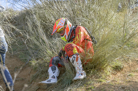 gomez: GUADALAJARA, SPAIN - FEBRUARY 22th 2015: Castilla-La Mancha cross country championship. Heber Izat Gomez Hernandez after an accident with his KTM motorcycle, during first race of season 2015, in Guadalajara, on February 22th 2015. (4 of 4)