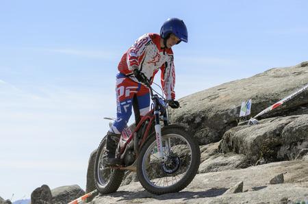 VALDEMANCO, SPAIN - MARCH 08th 2015: Madrid trial championship. Antonio de Hoyos Maroto drives his -Gas Gas- motorcycle over granite rocks, during first race of season 2015, in Valdemanco, on March 08th 2015.