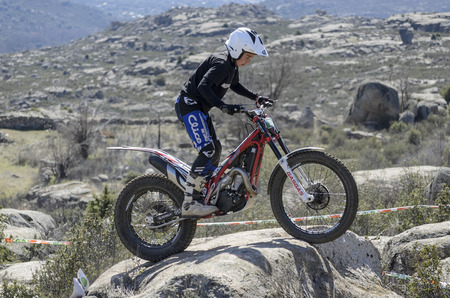 VALDEMANCO, SPAIN - MARCH 08th 2015: Madrid trial championship. Moment when Pablo Garcia Fernandez is going through a rock, during first race of season 2015, in Valdemanco, on March 08th 2015.