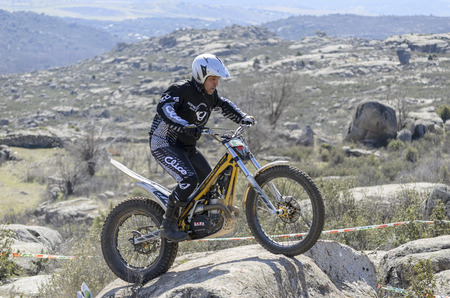 VALDEMANCO, SPAIN - MARCH 08th 2015: Madrid trial championship. Moment when Raul Pe?a Casado is going through a rock, during first race of season 2015, in Valdemanco, on March 08th 2015.