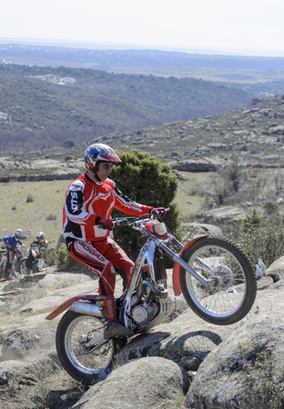 VALDEMANCO, SPAIN - MARCH 08th 2015: Madrid trial championship. Moment when Juan Luis Fernandez Rodriguez is jumping over granite rocks, during first race of season 2015, in Valdemanco, on March 08th 2015.