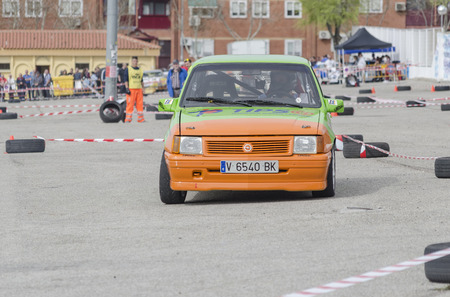 he is public: MEJORADA DEL CAMPO, SPAIN - MARCH 29th 2015: Car rally, of slalom, at public street. Juan Carlos Checa Gonzalez with his Opel Corsa, in Mejorada del Campo, on March 29th 2015. He finished in seventh position -Novice ranking-. Editorial