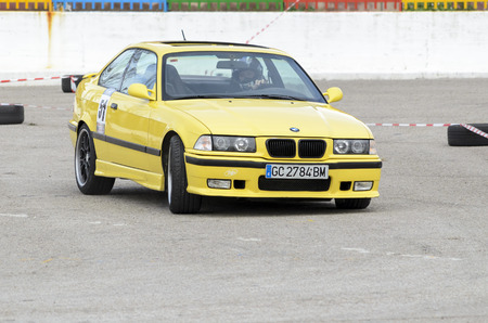 he is public: MEJORADA DEL CAMPO, SPAIN - MARCH 29th 2015: Car rally, of slalom, at public street. Elias Lasa Bercial with his Bmw M3, in Mejorada del Campo, on March 29th 2015. He finished in fifth position -Open ranking-.