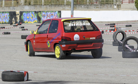 perez: MEJORADA DEL CAMPO, SPAIN - MARCH 29th 2015: Car rally, of slalom, at public street. Antonio Muela Perez with his Peugeot 106, in Mejorada del Campo, on March 29th 2015. He finished in fifth position -Novice ranking-. Editorial