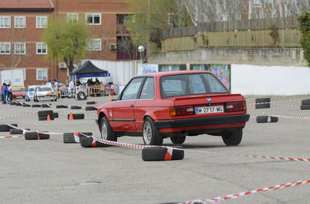MEJORADA DEL CAMPO, SPAIN - MARCH 29th 2015: Car rally, of slalom, at public street. David Cereijido Odriozola with his Bmw 320i, in Mejorada del Campo, on March 29th 2015. He finished in fourteenth position -Novice ranking-.