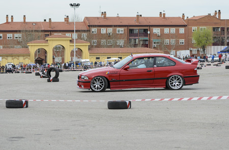 he is public: MEJORADA DEL CAMPO, SPAIN - MARCH 29th 2015: Car rally, of slalom, at public street. Francisco Barriga Valencia with his Bmw M3, in Mejorada del Campo, on March 29th 2015. He finished in second position -Open ranking-. Editorial