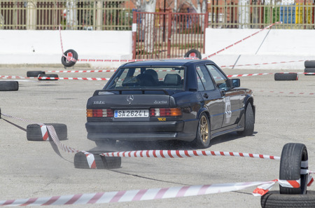 he is public: MEJORADA DEL CAMPO, SPAIN - MARCH 29th 2015: Car rally, of slalom, at public street. Juan Carlos Lopez Olmo with his Mercedes 190, in Mejorada del Campo, on March 29th 2015. He finished in eighth position -Open ranking-. Editorial