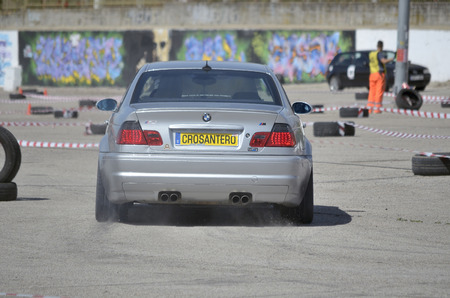 ruiz: MEJORADA DEL CAMPO, SPAIN - MARCH 29th 2015: Car rally, of slalom, at public street. Jose Maria Ruiz with his Bmw M3, in Mejorada del Campo, on March 29th 2015. He finished in first position -Open ranking-. Editorial