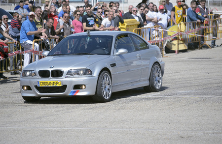 he is public: MEJORADA DEL CAMPO, SPAIN - MARCH 29th 2015: Car rally, of slalom, at public street. Jose Maria Ruiz with his Bmw M3, in Mejorada del Campo, on March 29th 2015. He finished in first position -Open ranking-. Editorial