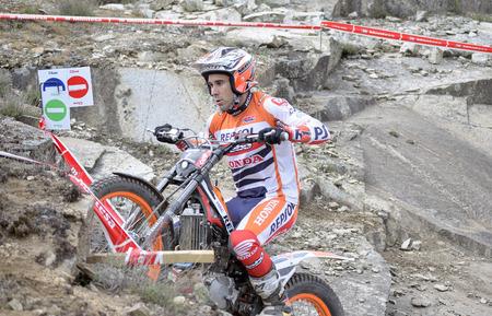 repsol honda: LOZOYUELA, SPAIN - APRIL 12th 2015: Spain trial championship. Moment when Toni Bou is ready tos jump over granite rocks, in Lozoyuela, on April 12th 2015. He won the race.