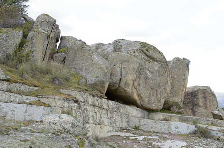 singular: Singular and large rocks located in an environment of rock mountains