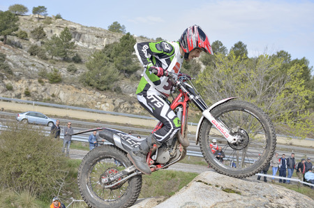 LOZOYUELA, SPAIN - APRIL 12th 2015: Madrid trial championship. Moment when Roberto Bautista Gutierrez drives a Gas Gas motorcycle over granite rocks, in Lozoyuela, on April 12th 2015.