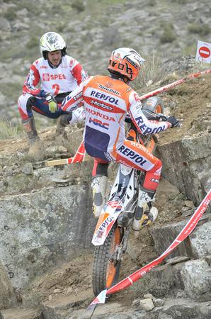repsol honda: LOZOYUELA, SPAIN - APRIL 12th 2015: Spain trial championship. Moment when Toni Bou is jumping over granite rocks, in Lozoyuela, on April 12th 2015. He won the race. Editorial