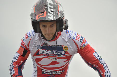 LOZOYUELA, SPAIN - APRIL 12th 2015: Spain trial championship. Portrait of Jeroni Fajardo over his motorcycle, in Lozoyuela, on April 12th 2015. He finished in 2nd position (TR1).