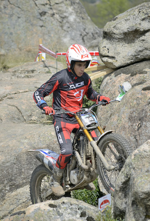 LOZOYUELA, SPAIN - APRIL 12th 2015: Spain trial championship. Moment when Jaume Rossello is ready to jump over granite rocks, in Lozoyuela, on April 12th 2015. He finished 5th (TR2 level).