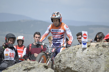 LOZOYUELA, SPAIN - APRIL 12th 2015: Spain trial championship. Moment when Toni Bou is ready to jump over granite rocks, in Lozoyuela, on April 12th 2015. He won the race (TR1 level).