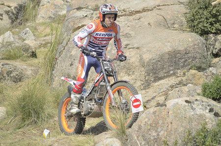 champion of spain: LOZOYUELA, SPAIN - APRIL 12th 2015: Spain trial championship. The world champion, Toni Bou, drives his motorcycle, in Lozoyuela, on April 12th 2015. He won the race (TR1 level).