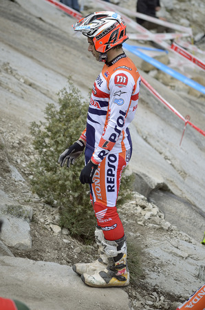 champion spain: LOZOYUELA, SPAIN - APRIL 12th 2015: Spain trial championship. The world champion, Toni Bou, is thinking about race, in Lozoyuela, on April 12th 2015. He won the race (TR1 level). Editorial