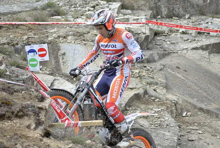 LOZOYUELA, SPAIN - APRIL 12th 2015: Spain trial championship. Moment when Toni Bou is ready to jump over granite rocks, in Lozoyuela, on April 12th 2015. He won the race.