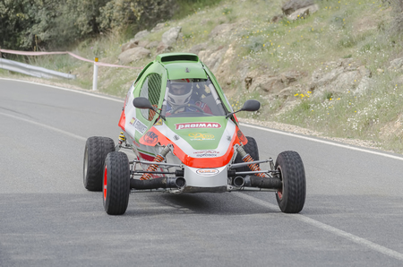 pull out: LA CABRERA, SPAIN - APRIL 25th 2015: Madrid rally championship. Nelson Fernandez is driving his -Demoncar-, during the ascent to -La Cabrera-, on April 25th 2015. He had to pull out of the race. Editorial