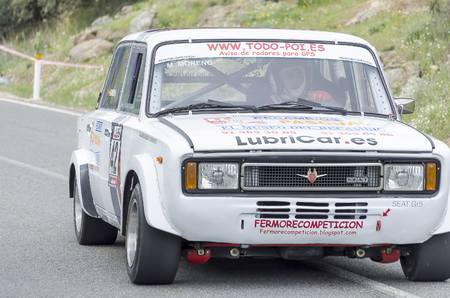 manuel: LA CABRERA, SPAIN - APRIL 25th 2015: Madrid rally championship. Manuel Moreno is driving his -Seat 124-, during the ascent to -La Cabrera-, on April 25th 2015. He had to pull out of the race.